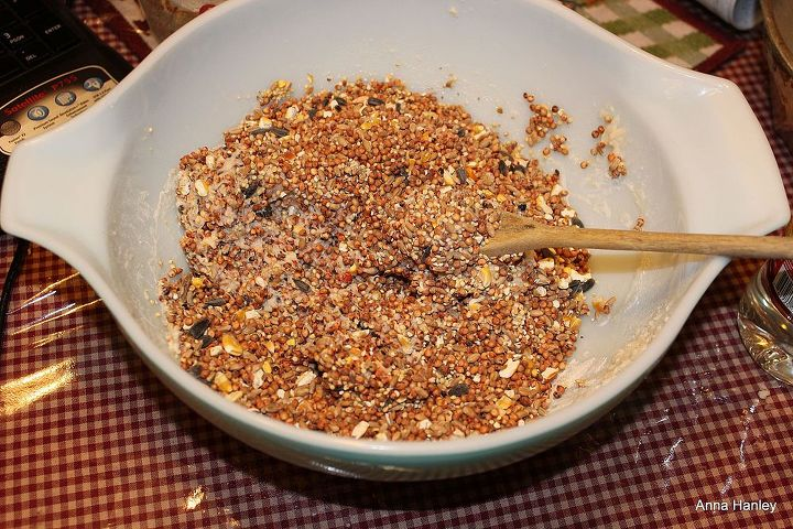 3. Add your bird seed and stir coating the seed well with a wooden spoon. Then pour it into your greased bundt pan