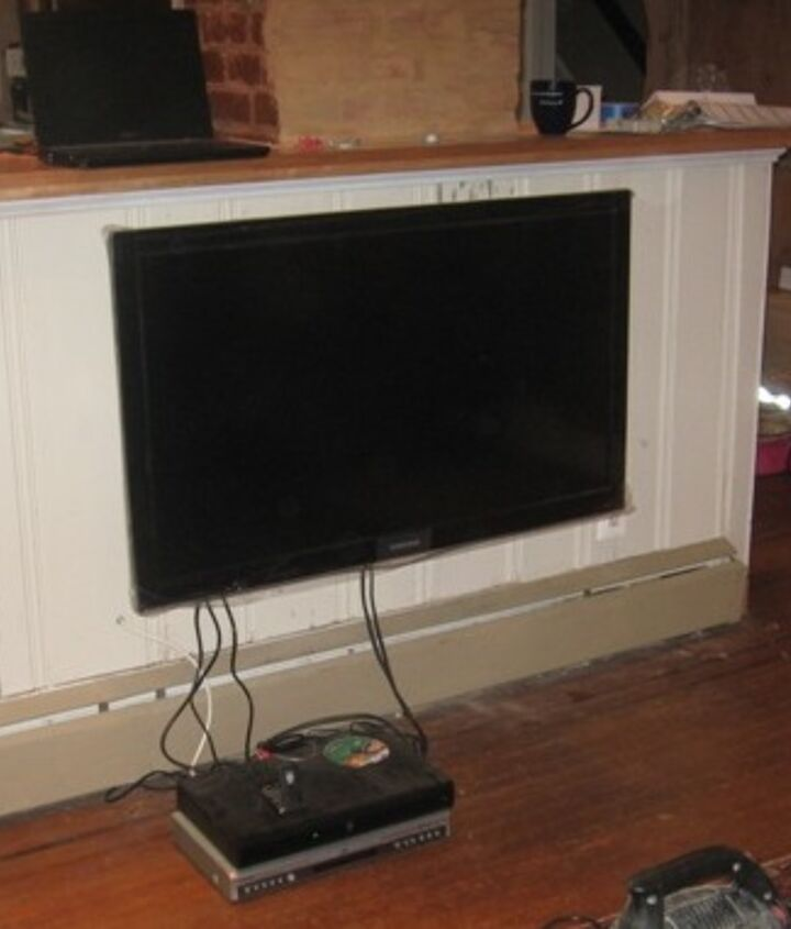 "low hung living room TV. 16"" from the floor"