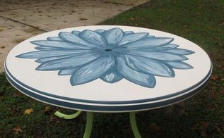 hand painted patio table salvaged from the dumpster using annie sloan aubusson blue, chalk paint, outdoor furniture, painted furniture, patio, Pretty blue flower on top painted with Annie Sloan chalk paint I used Aubusson Blue mixed with Old White to create shades and shadows The legs are spray painted Green Apple to symbolize the stem of the flower