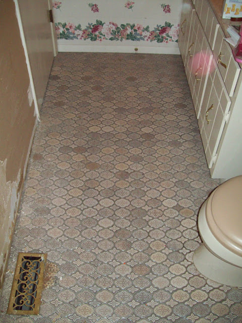 The 1970's tile which was taupe which matched the taupe toilet.  Yuck.
