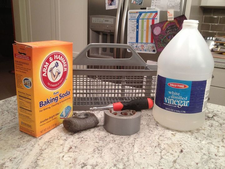 Supplies for cleaning your dishwasher. You can almost never go wrong with white vinegar and baking soda.