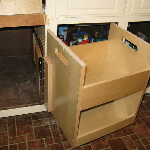 """Here you can see how they built this pull out box on a piano hinge and it has 2 storage sections.  There is a huge cavity inside this cabinet that they got in there, built two (2) huge flat trays to pull """"over"""" to the pullout!"""