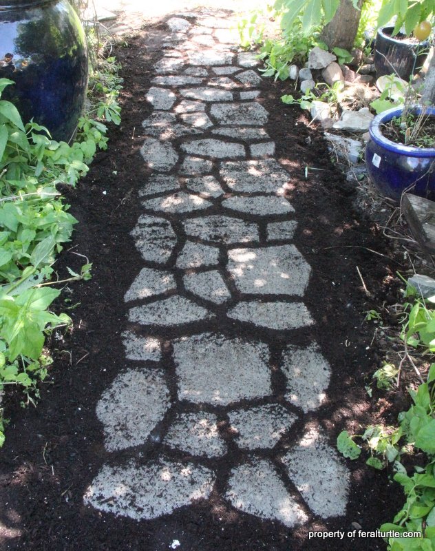 building a cobblestone path with moss, concrete masonry, flowers, gardening, landscape, outdoor living, A cobblestone path created from ready mix concrete