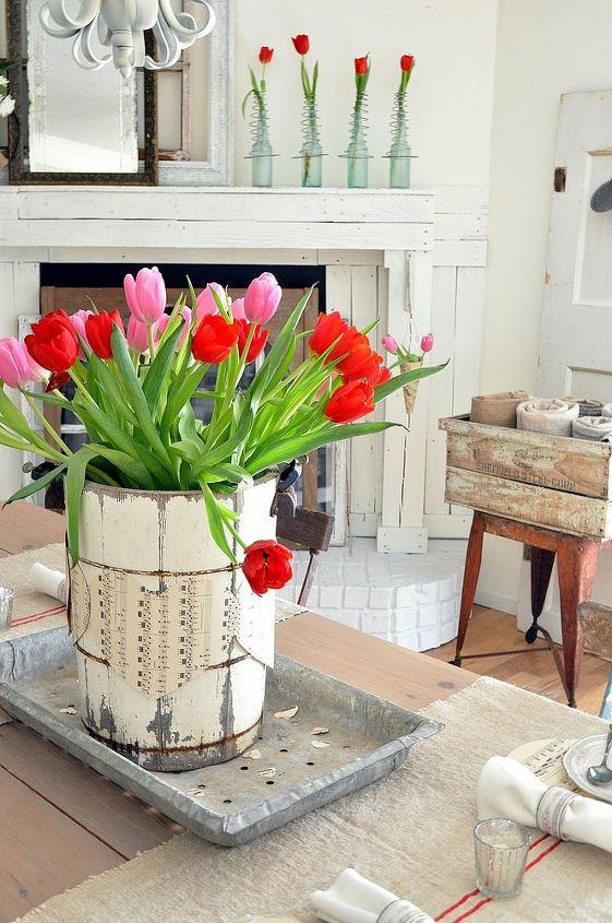 A vintage ice cream bucket wrapped in music sheet hearts make a perfect centerpiece.