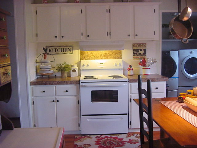 kitchen makeover, home decor, kitchen design, Painting the cabinets white made the stove just blend in love it