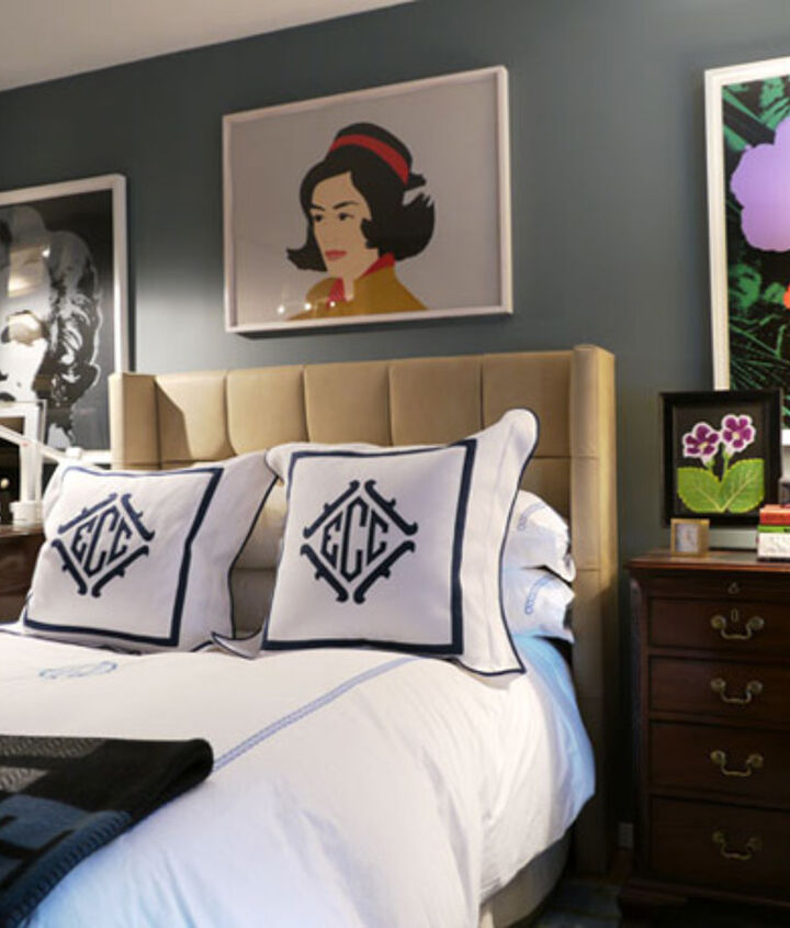 We love the rich blue-gray walls in this bedroom - it brings out the colors in the artwork on the walls!