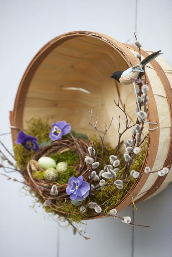 Old baskets and some simple flowers, fake birds, butterflies, and Easter eggs create an attractive door piece or walkway accent.