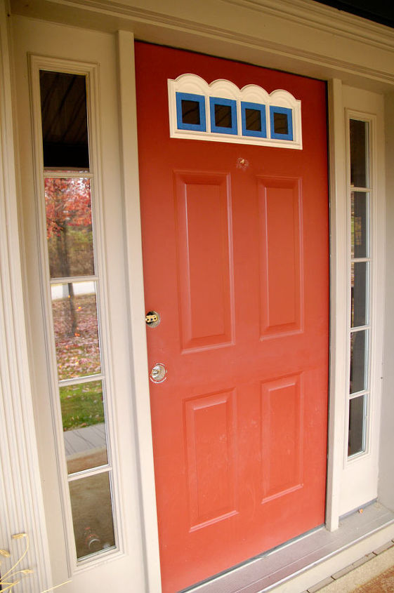 I started with this red fiberglass door with white trim.