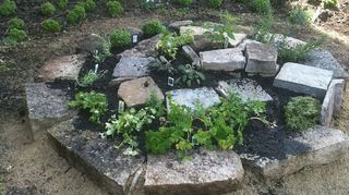 our herb spiral, gardening, landscape, Here is our first attempt the stone size we use is wide so you can see why I made the second one larger for more growing space