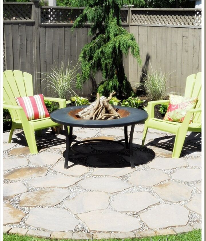 Last year we added a couple more chairs and a new fireplace.  http://www.recapturedcharm.com/2010/06/fire-pit-patio.html