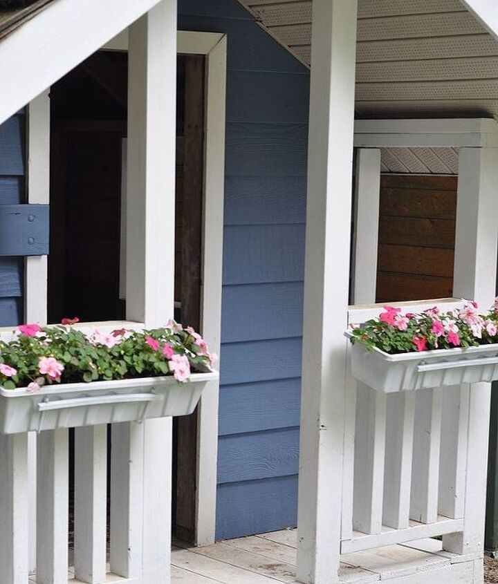 The flower boxes easily slid into their brackets and now frame the door into the play house.