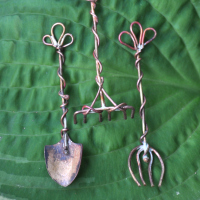 Shovel, rake and pitchfork. Wouldn't these be great for a fairy, bonsai or mini-zen garden?