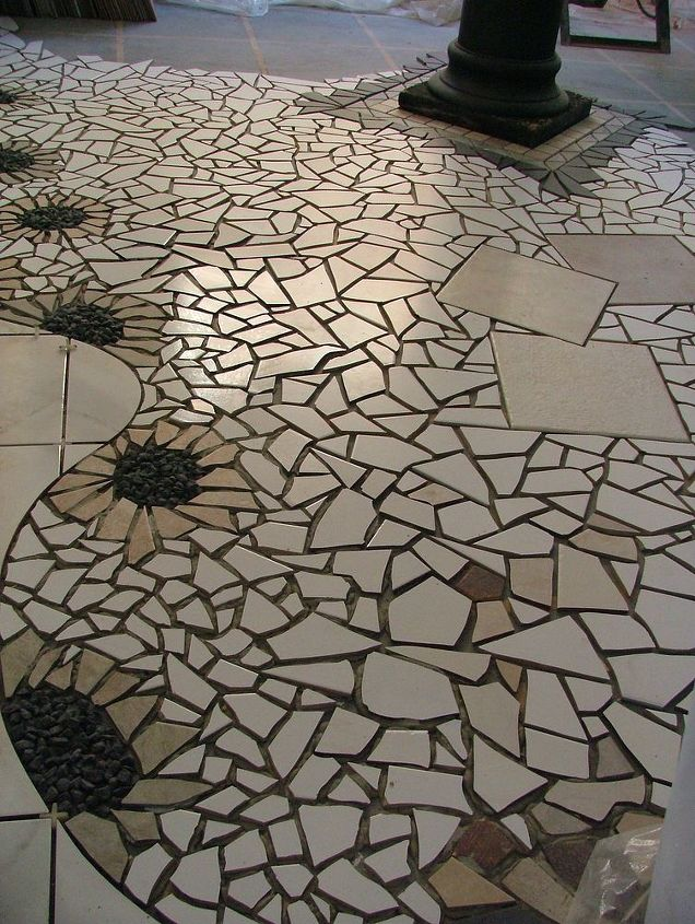 This is part of a gallery floor I designed several years back. I wanted to come up with a design that would lead the customers from one area to the next.