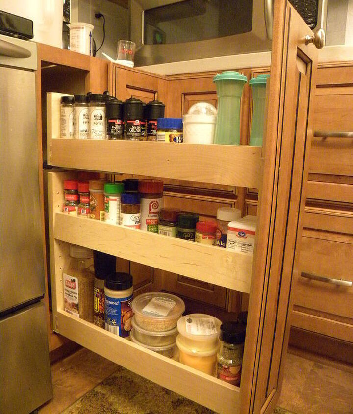 Spice pull-out base cabinet to the right of the range.