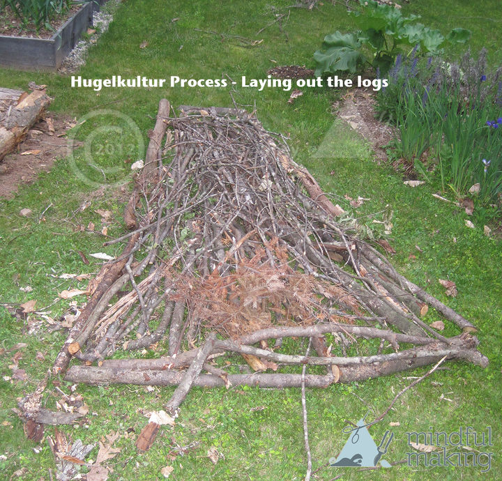 First layer of logs, sticks, twigs.