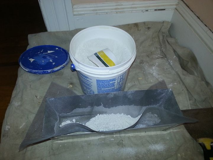 Use a mixable powdered drywall compound. Many actually contain plaster and will shrink less.