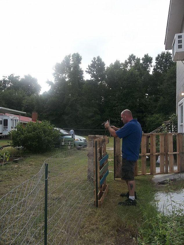 my husband working on a gate