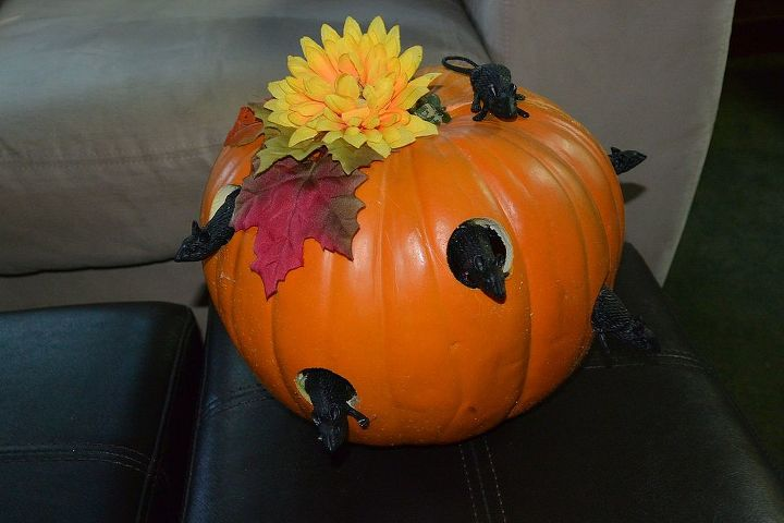 My $1.00 pumpkin. My husband drilled holes in it & then I bought the little mice from the Dollar store.
