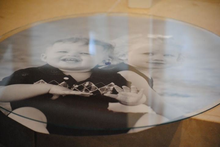 First, have a favorite photo printed large enough to fit the clock face.  Then use the glass as a template to trace around the photo and trim to size.