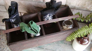 , Stained tool caddy used as a silverware napkins holder on porch