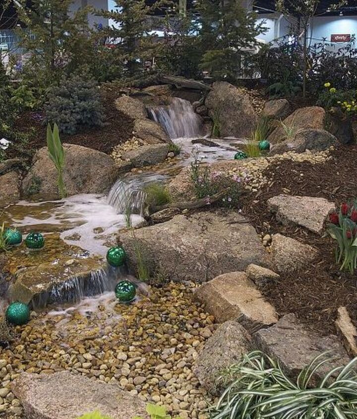 A beautiful pondless waterfall enhances the way to Oz.
