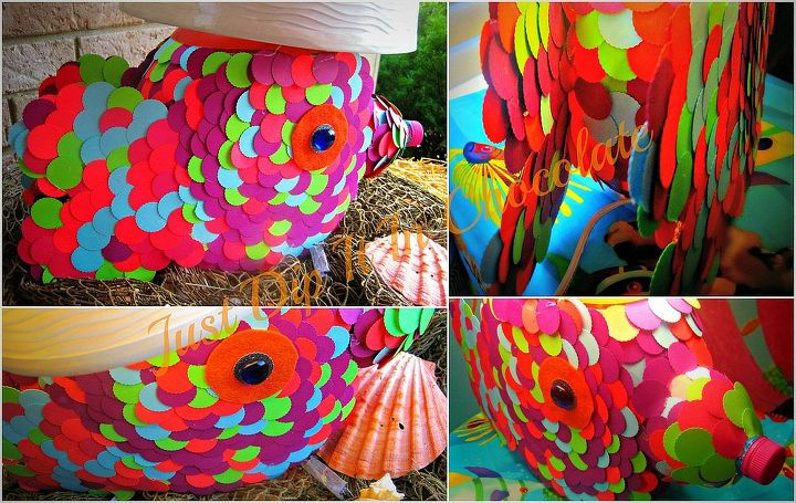 """After you cover """"the fish with scales"""" it's time to add a few more details like the fins which is just heart shaped cardboard boxes  cut outs attached to the container and beads for the eyes"""