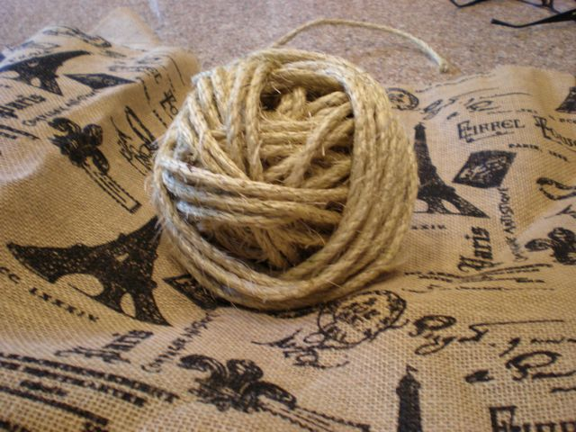 Printed Burlap ($10 a yard) and some twine....from the basment stash.