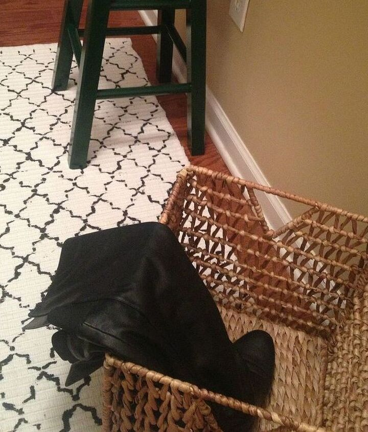"""To keep the entryway space clear I designated a basket for shoes. The basket was a score from IKEA's """"As-is"""" Section for $10.00!"""