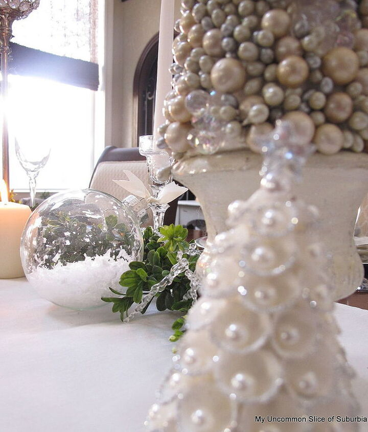 Faux snow and pearls fill the glass ornaments