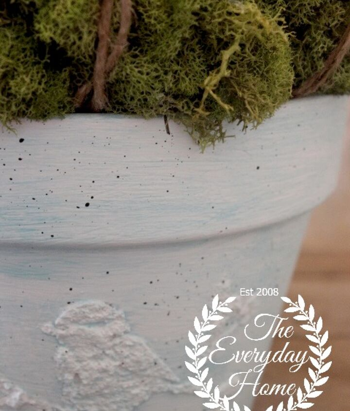 Textured paint and a stencil is all that is needed to create this cute little pot and turn a plain clay pot into a designer pot.