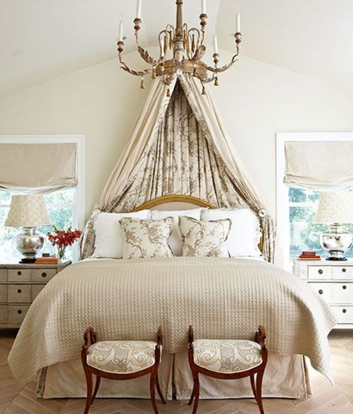 use a corona canopy - it has a curtain rail on the inside for your curtains.