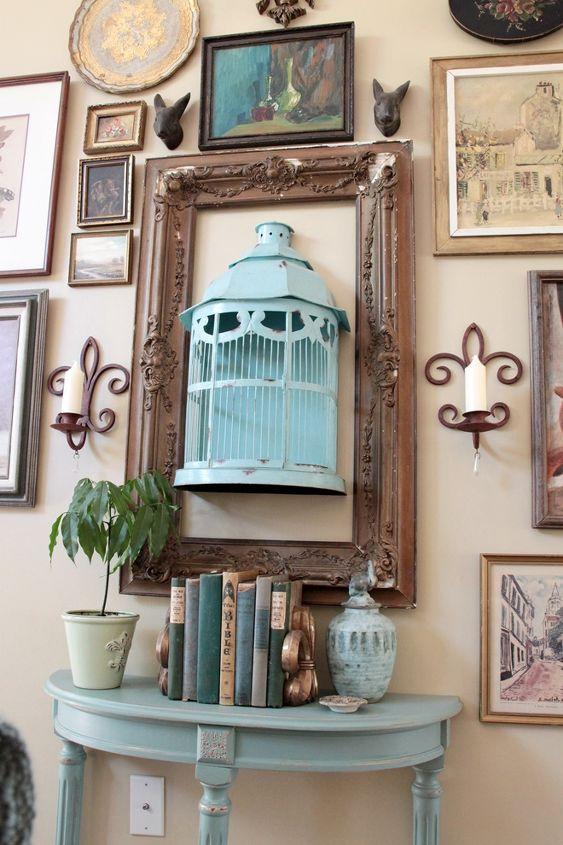 Full shot of the aqua birdcage and painted side table. This is my gallery wall put together entirely of yardsale and thriftstore items.