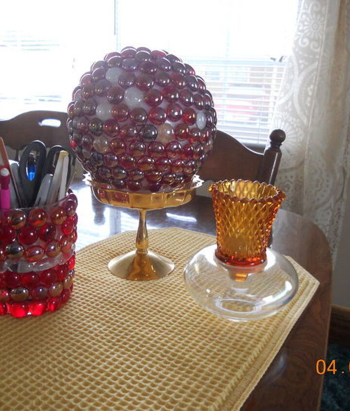 The larger ball is one of those ceiling globes , the pencil holder is just a dollar store small vase, the votive holder is 2 pieces of glassware i glued together.