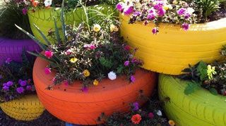 q how do i use old tires in my garden, gardening, Old Tires Turned into Flower Displays Not my photo Wish it was lol