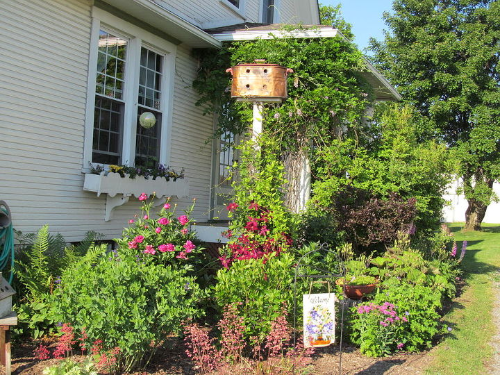 Another view of Copper boiler Bird house at side garden