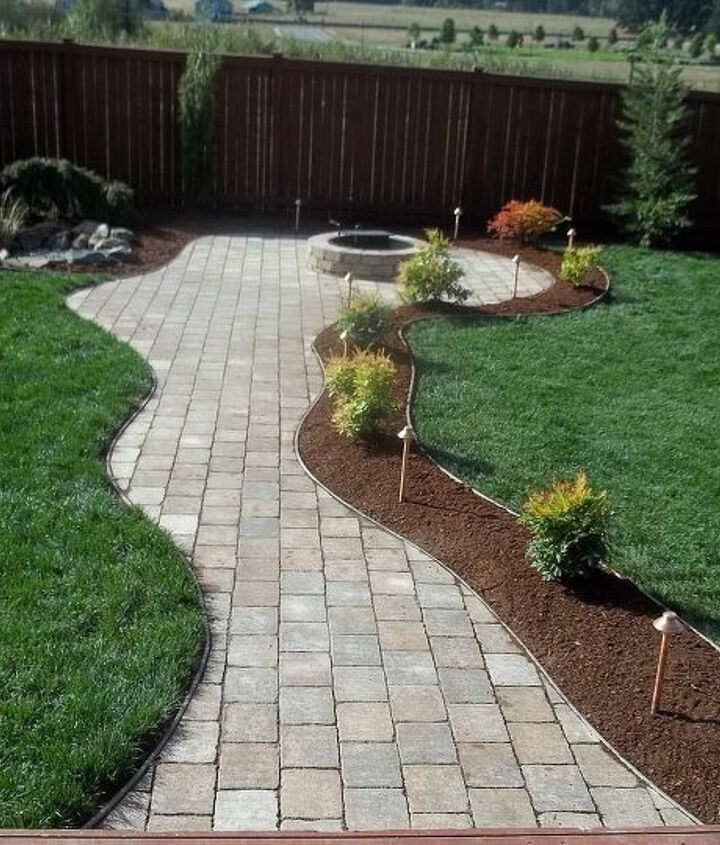 FX LED Lights, curvy pathway with firepit.  Water Feature on left