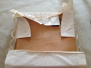 Using a staple gun, staple new fabric tautly around the cushion.