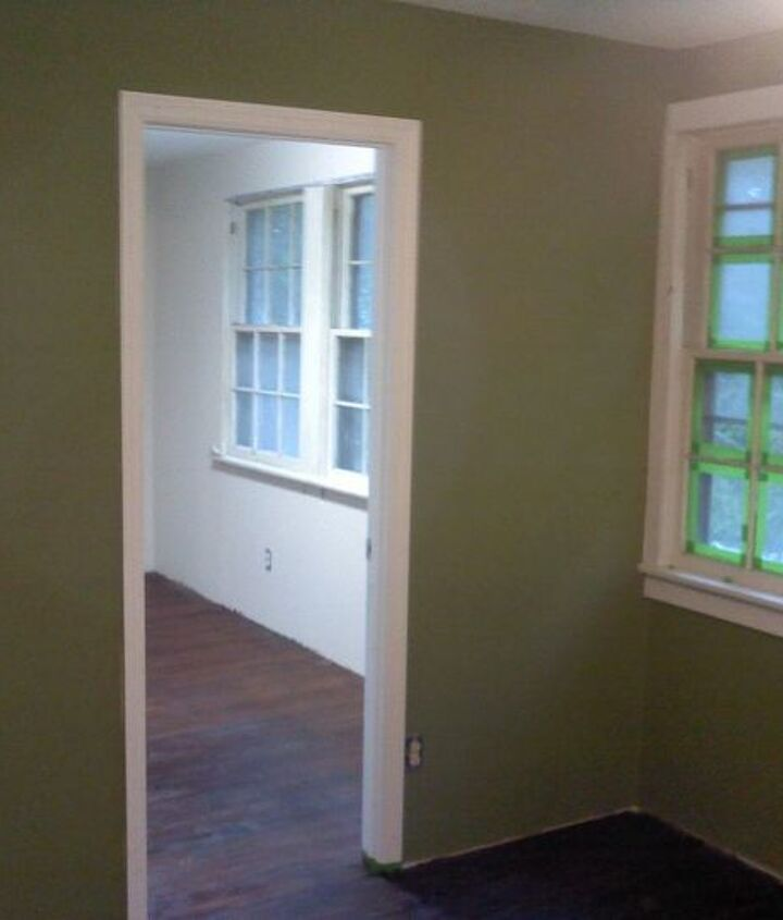 Painted the walls. Still need new windows, but they are custom windows, and very expensive. I guess we'll just repair and paint them.