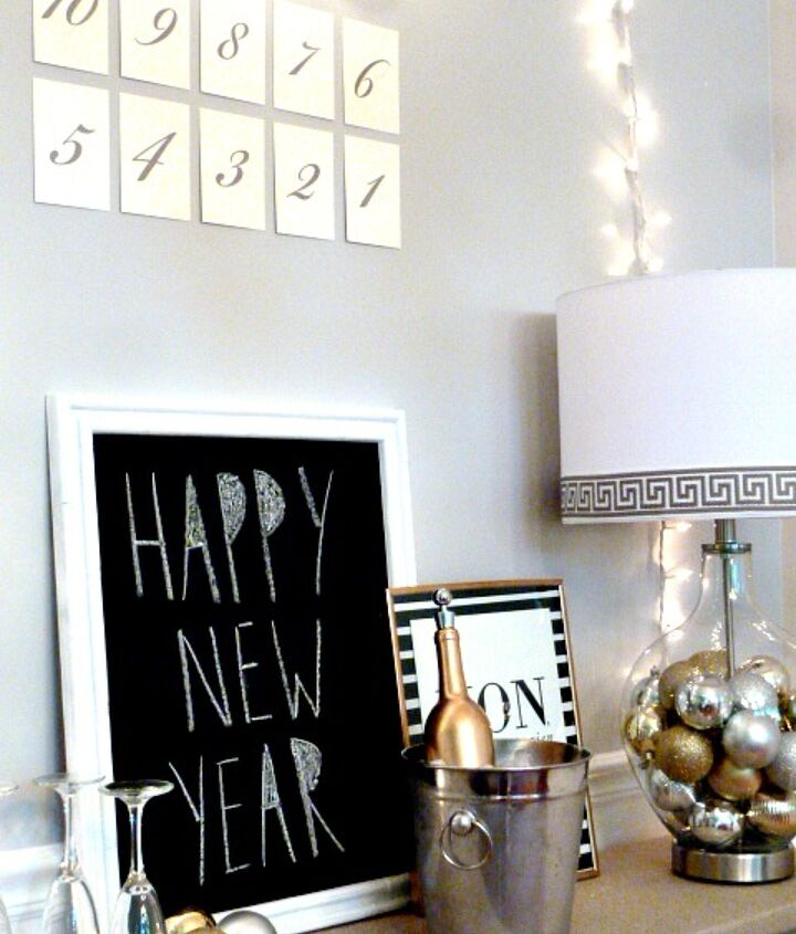 We added a countdown, some chalkboard art, framed gold foil art, twinkle lights, and some gilded bubbly to create a beautiful festive scene that your guests will love!