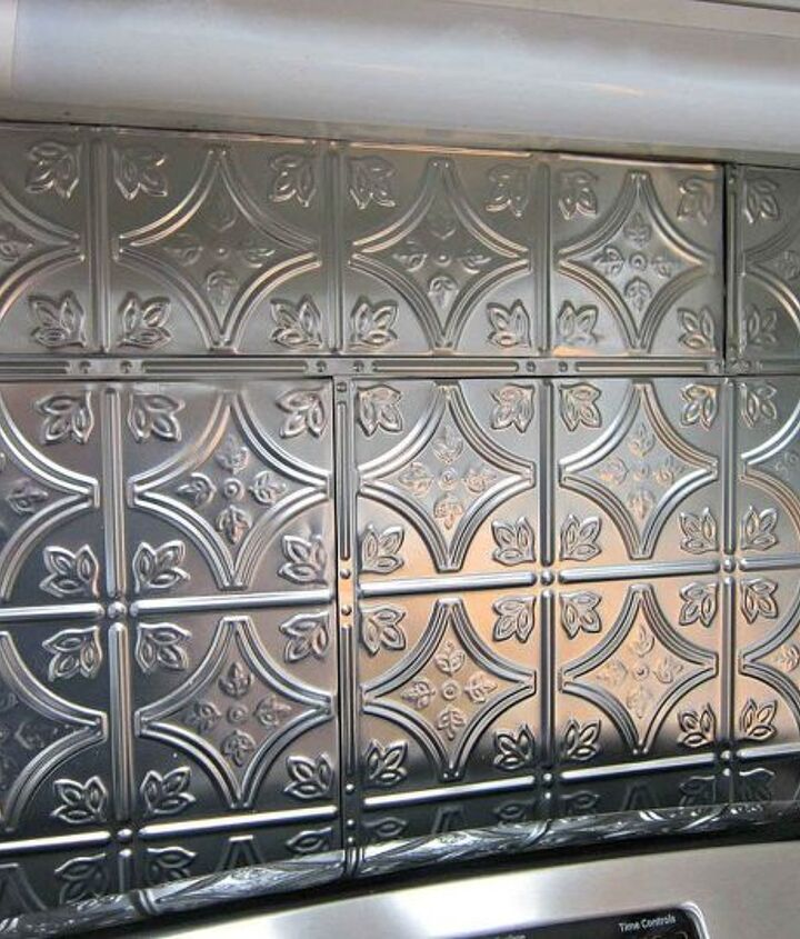 Tin ceiling tiles were used for the backsplash.  They were so easy to work with.  You cut them using tin snips and apply to wall with liquid nails.