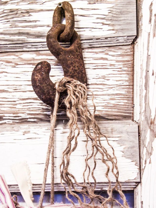 I love these old rustic hooks.  This smaller one is just perfect for hanging my wreath.
