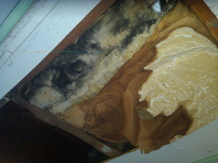 Insulation prior to removal. Note the black staining. This is caused by air moving through the insulation up into the floor cavity. Floor temps were only 15 degrees above outside temps.