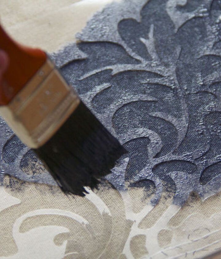 When you paint over your stencils, make sure you dab the paint instead of stroking it.