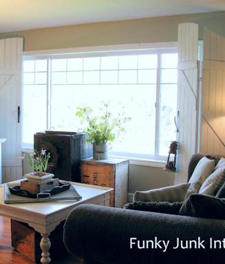 let the sun in with old gate window screens, diy, home decor, how to, windows, woodworking projects, The gate inspired window screens flank the big picture window in the living room They re big but don t overpower the room due to being slightly folded up and white It s the first thing visitors notice when they come for a visit