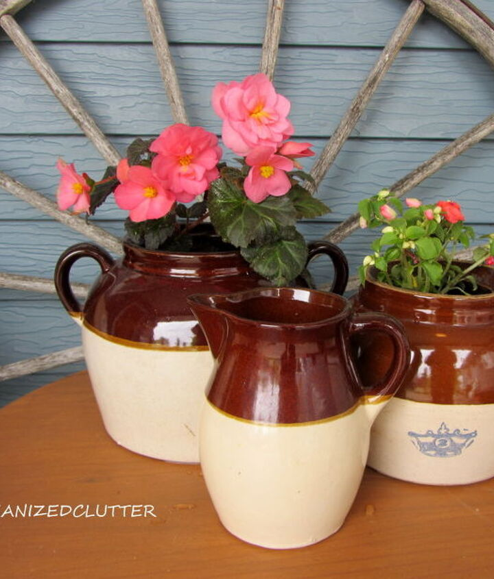 Stoneware bean pots planted with begonia and impatiens.