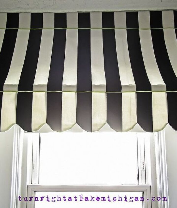 """The """"awning"""" is actually tension-mounted between the two bookcases, making it incredibly easy to remove while tying in the stripes of the cushion and adding a sense of whimsy to the whole area."""