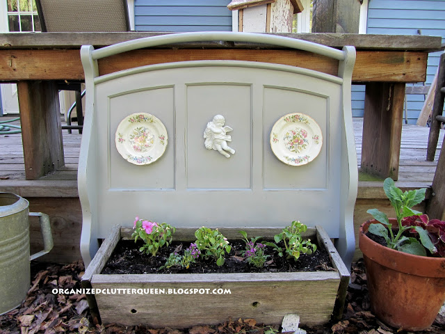 In Repurposing Old Futon Ends/Arms, I set futon parts in my flower bed.  http://organizedclutterqueen.blogspot.com/2012/06/repurposing-old-college-futon-in-flower.html