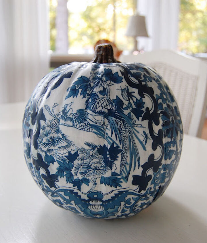 A blue & white pumpkin for the guest room, using the same pattern at the comforter/pillows.    Tutorial can be found here: http://betweennapsontheporch.net/country-living-inspired-decoupage-a-pumpkin/