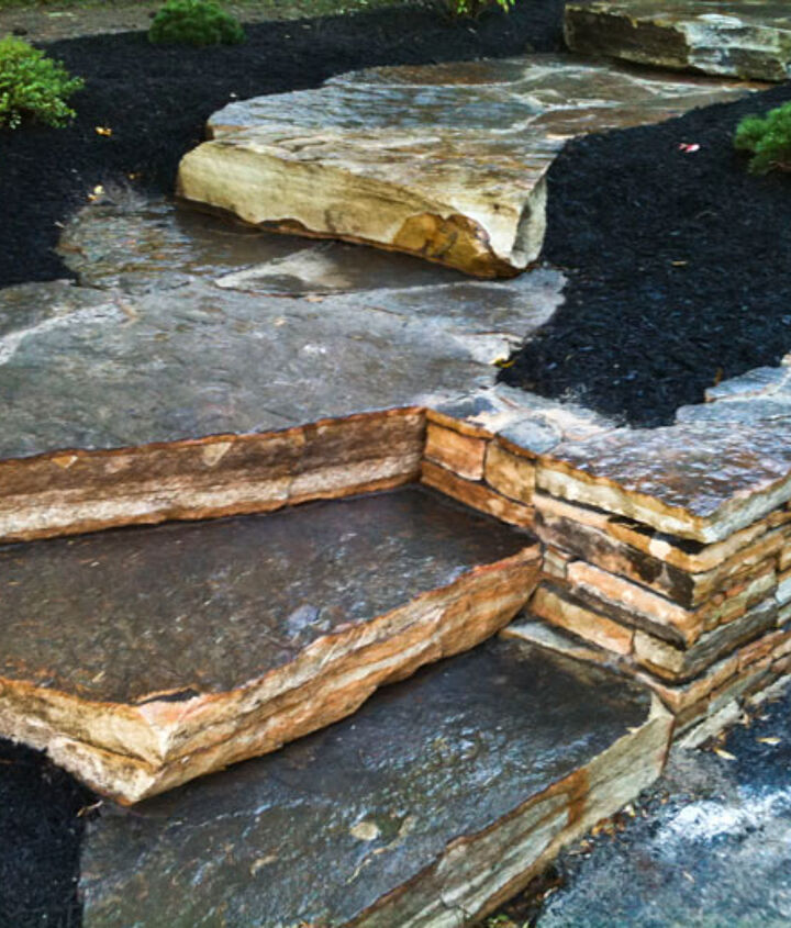 Our Lentzcaping crew removed the existing concrete stairs and installed antique and blue stone for a natural look.