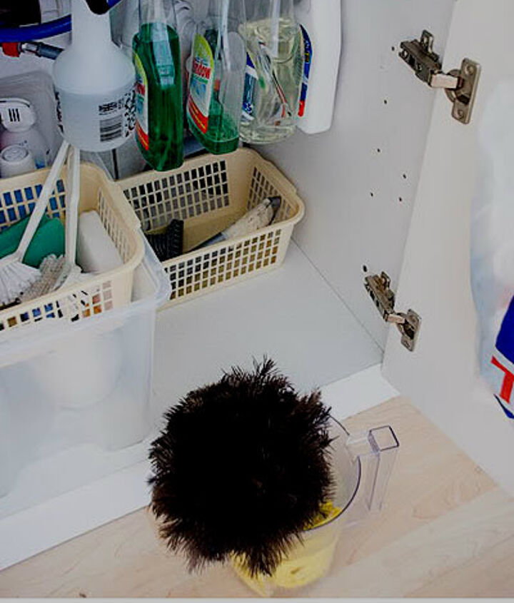 use tension rods to store cleaning supplies- keeps them up so that you can have more room for other things under your sink (visit the website for more tips like this)